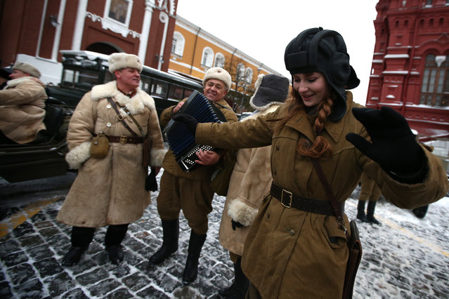 People in historical uniforms prepare for a parade at Red Square commemorating the 75th anniversary of the Red Army's defence of Moscow during the second world war in Moscow, Russia on November 7, 2016. (Photo by Stanislav Krasilnikov/TASS)