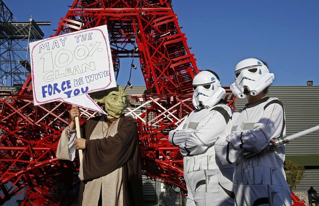 Activists from the AVAAZ NGO are dressed as Star Wars stormtroopers at a demonstration during the the World Climate Change Conference 2015 (COP21) in Le Bourget, near Paris, France, December 9, 2015. (Photo by Jacky Naegelen/Reuters)