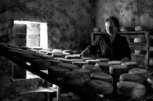 """""""Say traditional cheese"""". Up in the mountains, in a small village of Crete, Mrs Kalliopi keeps the tradition of making cheese alive. Time seems to stand still in this place to remind us how people worked and produced things without the means of technology. This is an old room made of stones, where cheese is preserved and matured in what they call """"cage conditions"""". Location: Geraki Crete Greece. (Photo and caption by Stella Meligounaki/National Geographic Traveler Photo Contest)"""