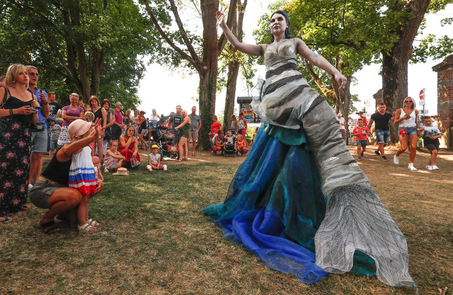 "An artist called ""La Sirene/The mermaid"" takes part in the festival ""Statues en Marche"" in Marche-en-Famenne, Belgium, July 22, 2018. (Photo by Yves Herman/Reuters)"