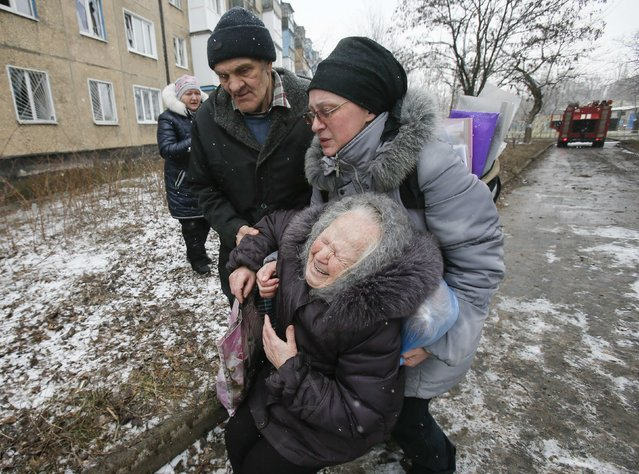 An elderly woman reacts after the residential block in which she lives in was damaged by a recent shelling, according to locals, on the outskirts of Donetsk, eastern Ukraine February 9, 2015. (Photo by Maxim Shemetov/Reuters)