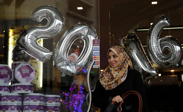 Palestinian women shop on the last day of 2015 in Gaza city, Thursday, December 31, 2015. (Photo by Hatem Moussa/AP Photo)