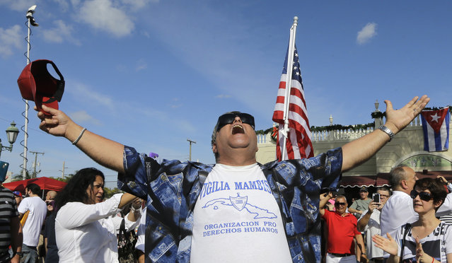 A member of the Cuban community celebrates the death of Fidel Castro, Saturday, November 26, 2016, in the Little Havana area in Miami. Castro, who led a rebel army to improbable victory in Cuba, embraced Soviet-style communism and defied the power of 10 U.S. presidents during his half century rule, died at age 90. (Photo by Alan Diaz/AP Photo)