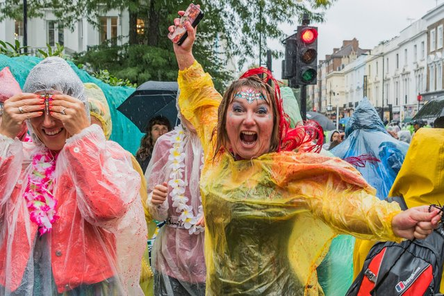 The rain comes but fails to dampen spirits too much during the Notting Hill Carnival in London, Britain on August 26, 2018. (Photo by Guy Bell/Rex Features/Shutterstock)