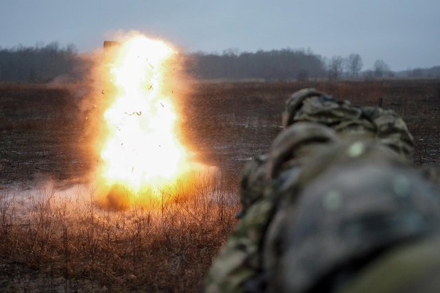 Soldiers assigned to A Company, 326th Brigade Engineer Battalion, 101 Airborne Division (AirAssault) detonate a explosive breeching charge during a training exercise at Fort Campbell, Kentucky, U.S., February 12, 2020. (Photo by Bryan Woolston/Reuters)