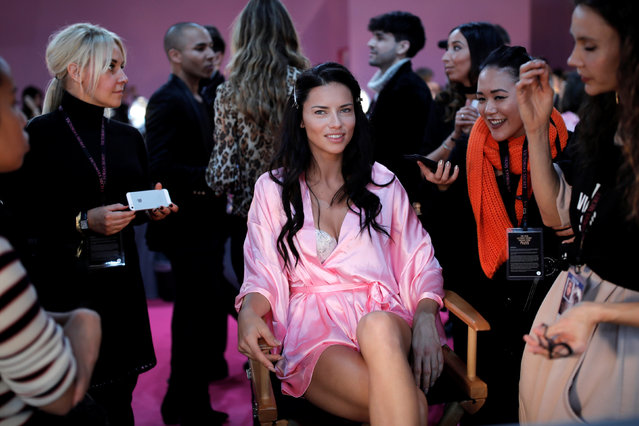 Model Adriana Lima gets ready backstage before the Victoria's Secret Fashion Show at the Grand Palais in Paris, France, November 30, 2016. (Photo by Benoit Tessier/Reuters)