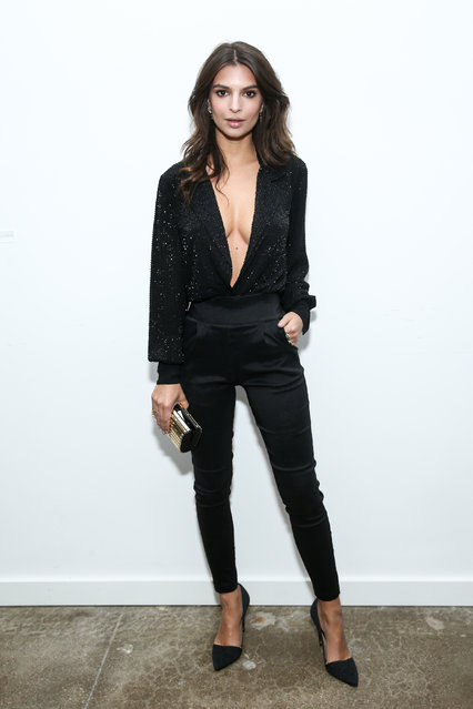 Emily Ratajkowski strikes a pose in Vince Camuto heels and a clutch at the brand's holiday dance party, held at Ashlee Margolis' The A List offices, Beverly Hills, CA on December 7, 2016. (Photo by John Salangsang/BFA.com)