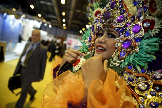 A woman in a costume stands in the Asia area of the FITUR International Tourism Trade Fair in Madrid, Spain, January 20, 2016. (Photo by Andrea Comas/Reuters)