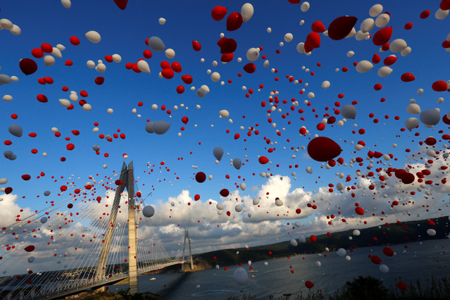 Red and white balloons are released during the opening ceremony of newly built Yavuz Sultan Selim bridge, the third bridge over the Bosphorus linking the city's European and Asian sides in Istanbul, Turkey, August 26, 2016. (Photo by Murad Sezer/Reuters)