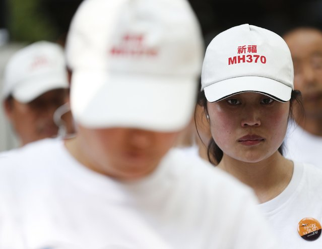 A relative of a passenger aboard missing Malaysia Airlines flight MH370 reacts to music at a remembrance event on the one year anniversary of its disappearance in Kuala Lumpur, March 8, 2015. Malaysia's Prime Minister Najib Razak said on Sunday Malaysia remains committed to the search for the missing MH370 jetliner a year after it vanished without trace and he is hopeful it will be found. REUTERS/Olivia Harris (MALAYSIA - Tags: TRANSPORT DISASTER ANNIVERSARY)