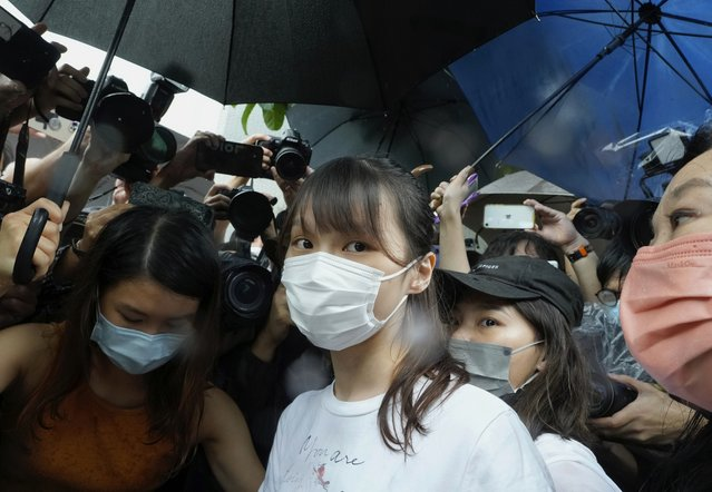 Agnes Chow, center, a prominent pro-democracy activist who was sentenced to jail last year for her role in an unauthorized protest, is released in Hong Kong Saturday, June 12, 2021. Chow rose to prominence as a student leader in the now defunct Scholarism and Demosisto political groups, alongside other outspoken activists such as Joshua Wong and Ivan Lam. (Photo by Vincent Yu/AP Photo)