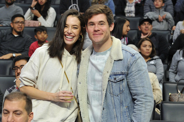 Actors Adam DeVine and Chloe Bridges attend a basketball game between the Los Angeles Clippers and the Sacramento Kings at Staples Center on December 26, 2018 in Los Angeles, California. (Photo by Allen Berezovsky/Getty Images)