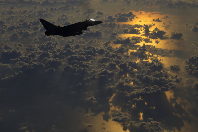A British RAF Typhoon aircraft escorts a C130 transport plane on its way to Jordan for an airdrop of paratroopers from the U.K.'s 16th Air Assault Brigade as part of an exercise conducted jointly with Jordanian soldiers on Wednesday, June 23, 2021. (Photo by Petros Karadjias/AP Photo)