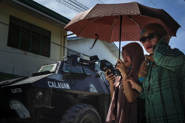 Residents flock to polling precincts to cast their votes on January 21, 2019 in Cotabato City, southern Philippines. Nearly three million Filipinos in region of Mindanao are voting in a plebiscite which could pave the way for lasting peace at the country's Muslim-majority southern region and place them under a substantially more autonomous regional government. Based on reports, Monday's plebiscite on the Bangsamoro Organic Law could provide a political solution to decades of fighting between Islamist separatists and the Philippine army which has left at least 120,000 people dead over years of violence. (Photo by Jes Aznar/Getty Images)