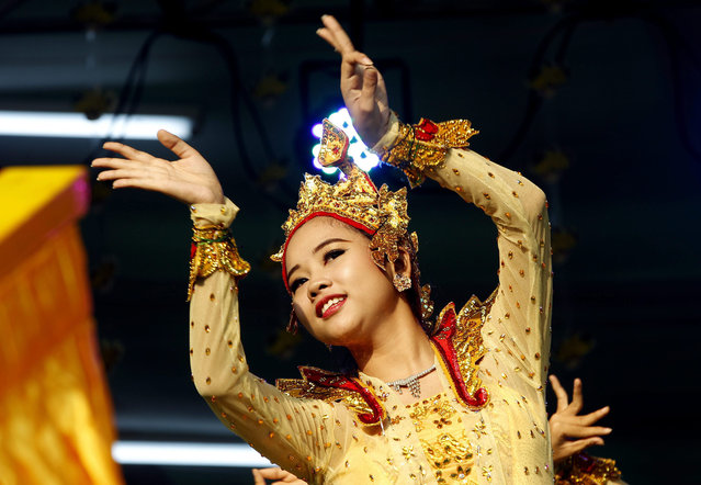 A Myanmar woman performs a dance with a traditional angel dress during the opening ceremony of the Yangon Government water festival in Yangon, Myanmar, 13 April 2015. The annual water festival is celebrated with large groups of people congregating to celebrate by splashing water and throwing powder at each others faces as a symbolic sign of cleansing and washing away the sins from the old year to mark the traditional New Year in countries such as Myanmar, Thailand, Laos and Cambodia. (Photo by Nyein Chan Naing/EPA)