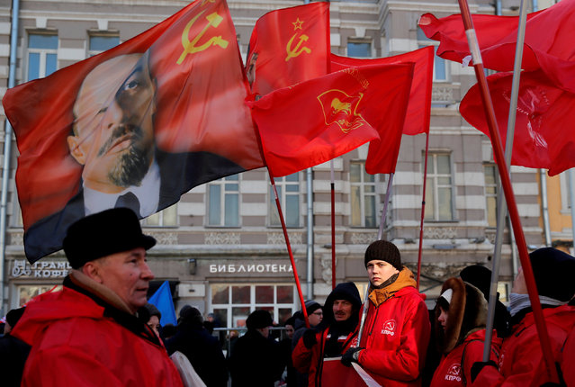 Activists and supporters of the Russian Communist Party gather before a procession to celebrate the Defender of the Fatherland Day, which was before known as Soviet Army and Navy Day, in Moscow, Russia February 23, 2019. (Photo by Maxim Shemetov/Reuters)