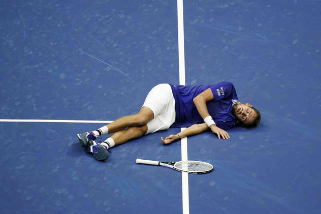 Daniil Medvedev, of Russia, reacts on the court after defeating Novak Djokovic, of Serbia, during the men's singles final of the US Open tennis championships, Sunday, September 12, 2021, in New York. (Photo by Seth Wenig/AP Photo)