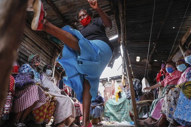 Group leader Jane Waithageni Kimaru, 60 years old, shows women how to fight off a potential rapist and escape, during a Taekwondo self-defense class for women in the Korogocho slum of Nairobi, Kenya, Thursday, September 16, 2021. (Photo by Brian Inganga/AP Photo)
