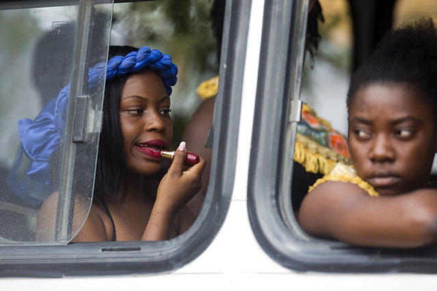 A dancer applies lipstick onboard a bus before the start of the Carnival parade in the Carrefour district of Port-au-Prince, Haiti, Tuesday, March 5, 2019. (Photo by Dieu Nalio Chery/AP Photo)