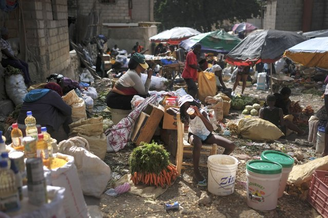 Vendors work at the Maché Tèt Dlo market in Port-au-Prince, Haiti, Tuesday, July 13, 2021. President Jovenel Moise was assassinated in his home on July 7. (Photo by Matias Delacroix/AP Photo)