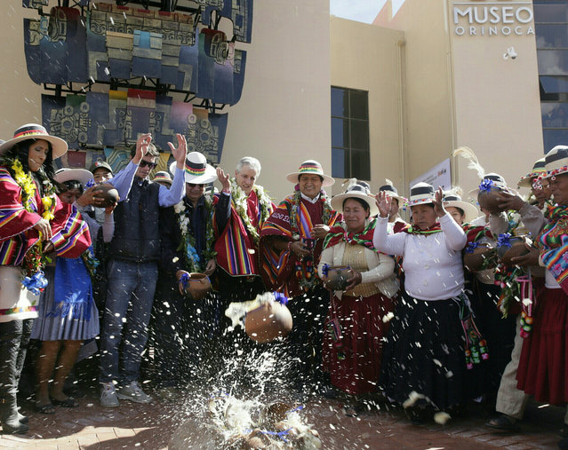 Bolivia's President Evo Morales (C) with government and local authorities throws liquid-filled pots as part of a ceremony inaugurating the Orinoca Museum in Orinoca, Bolivia February 2, 2017. (Photo by David Mercado/Reuters)
