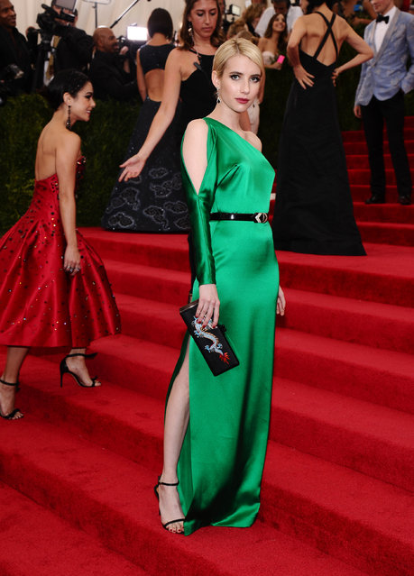 """Emma Roberts arrives at The Metropolitan Museum of Art's Costume Institute benefit gala celebrating """"China: Through the Looking Glass"""" on Monday, May 4, 2015, in New York. (Photo by Charles Sykes/Invision/AP Photo)"""