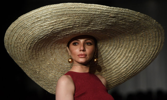 """A model presents a creation by Pakistani designer Zaheer Abbas on the first day of the """"Hum Showcase"""" Fashion Week in Karachi on April 18, 2019. (Photo by Asif Hassan/AFP Photo)"""