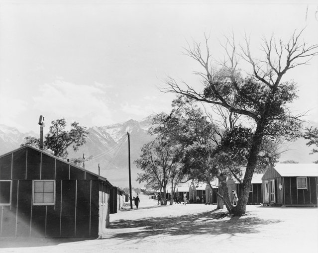 A view of the quarters at the Manzanar War Relocation Center in California, in this April - July 1942 handout photo. Mount Whitney, highest peak in the contiguous United States, is visible in the background. (Photo by Courtesy Dorothea Lange/Farm Security Administration and Office of War Information Collection/Library of Congress/Reuters)