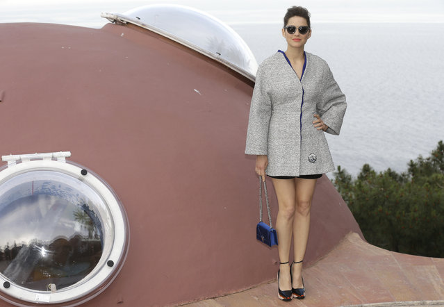 French actress Marion Cotillard arrives at the Dior Resort 2015 catwalk show presented in Cannes, southeastern France, Monday, May 11, 2015. (Photo by Lionel Cironneau/AP Photo)