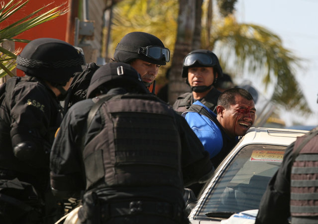 A man is detained by state police after workers of tomato farm labor camps allegedly invaded private property, according to state police, in the town of San Quintin, on Mexico's Baja peninsula, Saturday, May 9, 2015. Dozens of workers were injured in the clash, some seriously, according to a spokesman of the National, State and Municipal Alliance for Social Justice. (Photo by Roberto Armocida/La Jornada Baja California via AP Photo)