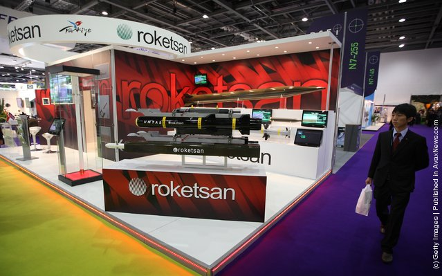 A visitor walks past the Turkish missile manufacturer Roketsan's stand at the Defence and Security Exhibition