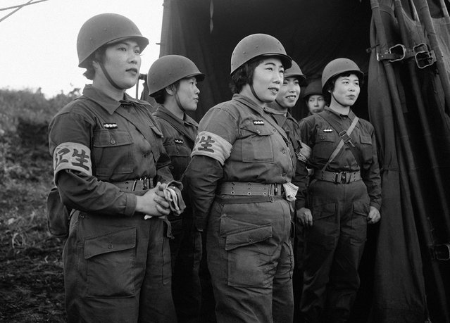Women nurses of Japan's newly-formed Self-Defense Corps man an aid station on Hokkaido, Japan, during maneuvers on October 20, 1955. Japanese forces, using U.S. – supplied equipment engaged in their first post-war military exercises with a U.S. advisory group and other foreign military observers on hand to watch the defense maneuvers against an imaginary invader of the Japanese island. (Photo by AP Photo via The Atlantic)