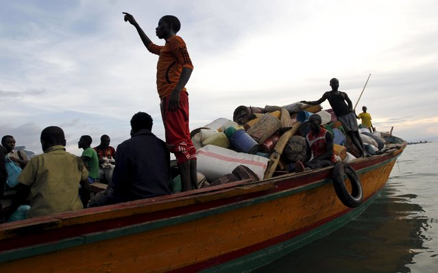Burundian refugees board a boat on the shores of Lake Tanganyika in Kagunga village in Kigoma region in western Tanzania to Kigoma township, May 17, 2015. (Photo by Thomas Mukoya/Reuters)