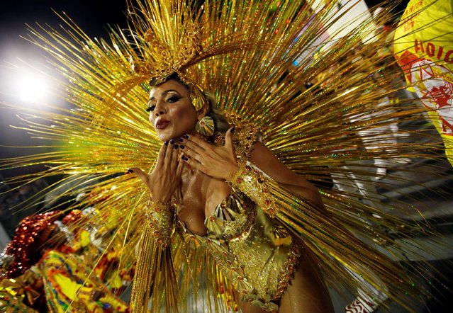 A reveller parades for the Tom Maior samba school during the carnival in Sao Paulo, Brazil, February 24, 2017. (Photo by Paulo Whitaker/Reuters)