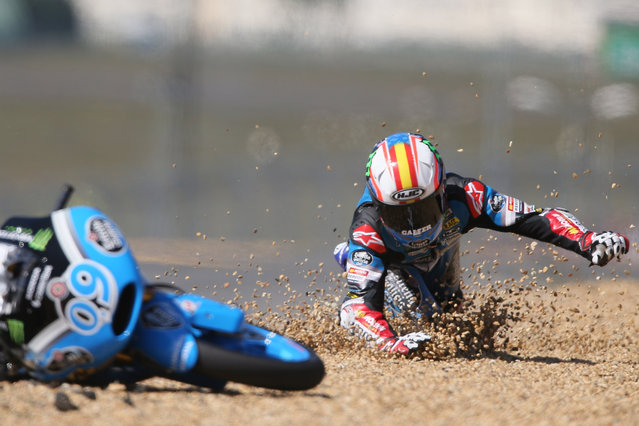 Spanish Moto 3 rider Joreg Navarro fall down during the France Motorcycle Grand Prix race at the Bugatti race track in Le Mans, western France, Sunday, May 17, 2015. (Photo by David Vincent/AP Photo)