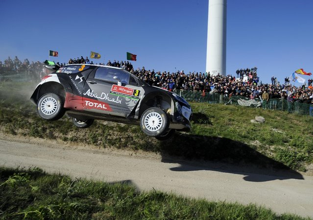 Citroen Total Abu Dhabi WRT driver Kris Meeke, from France, and his co-driver Paul Nagle, from Ireland, steer their Citroen DS3 WRC during the Portugal FIA World Rally Championship Sunday, May 24, 2015 in Lameirinha, Fafe, Portugal. (Photo by Paulo Duarte/AP Photo)