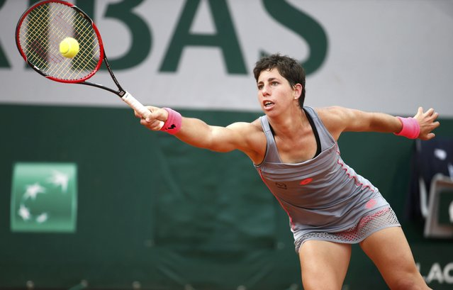 Carla Suarez Navarro of Spain plays a shot to Monica Niculescu of Romania during their women's singles match at the French Open tennis tournament at the Roland Garros stadium in Paris, France, May 25, 2015. (Photo by Vincent Kessler/Reuters)
