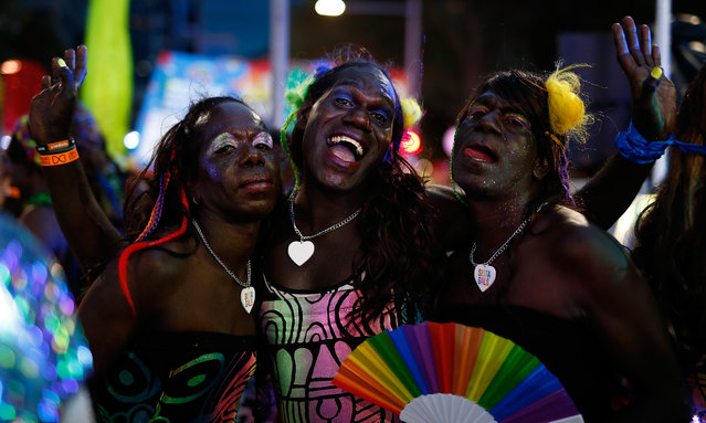 Members of the Tiwi Islands transgender community attend the Sydney Gay and Lesbian Mardi Gras parade on March 4, 2017 in Sydney, Australia. After a successful crowd funding campaign, a group of 30 transgender women from the remote Northern Territory Tiwi Islands travelled over 4,000 kilometres to Sydney to represent their community for the first time at the Sydney Gay and Lesbian Mardis Gras. (Photo by Zak Kaczmarek/Getty Images)