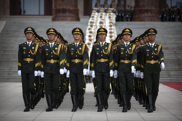 Honor guard members march in formation before a welcome ceremony for Turkish President Recep Tayyip Erdogan at the Great Hall of the People in Beijing, Tuesday, July 2, 2019. (Photo by Mark Schiefelbein/AP Photo)