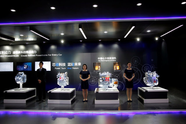 Geely Auto's staff members stand next to displays of its engine models during the Auto China 2016 show in Beijing, China April 25, 2016. (Photo by Kim Kyung-Hoon/Reuters)