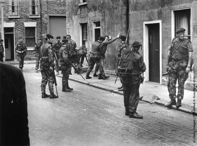 1971:  British troops searching a civilian in Belfast