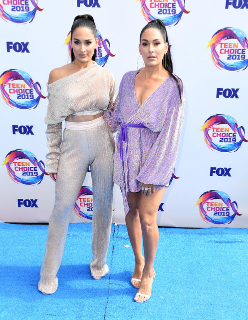 Nikki Bella and Brie Bella arrives at the FOX's Teen Choice Awards 2019 on August 11, 2019 in Hermosa Beach, California. (Photo by Steve Granitz/WireImage)