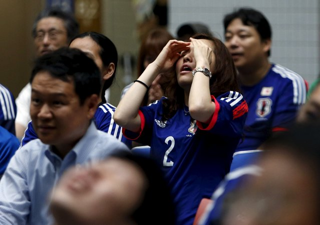 Japan's soccer fans react after England's Fara Williams scored an equalizer during their FIFA Women's World Cup semi-final soccer match, at a public viewing event in Tokyo, Japan, July 2, 2015. (Photo by Yuya Shino/Reuters)