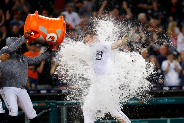 Detroit Tigers first baseman John Hicks is doused with water by third baseman Ronny Rodriguez after he hits a walk off grand slam in the 12th inning against the Baltimore Orioles at Comerica Park in Detroit, September 14, 2019. (Photo by Rick Osentoski/USA TODAY Sports)