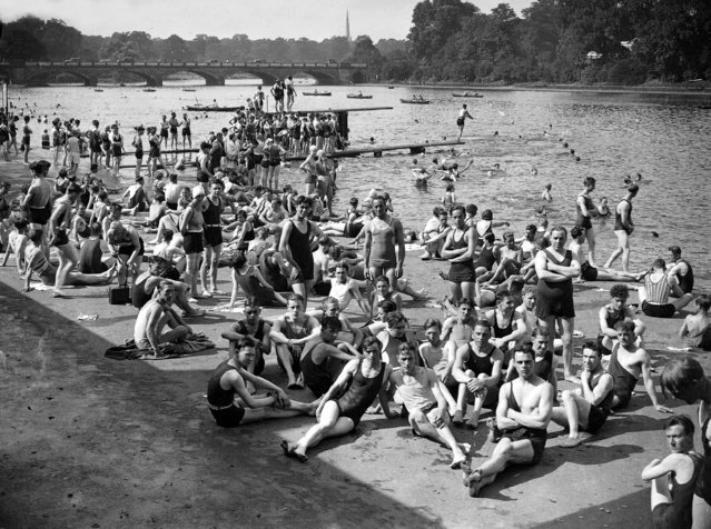 A crowd of people wearing swimwear bathing in the Serpentine during the high temperatures in London's Hyde Park, 27th August, 1930. (Photo by Popperfoto/Getty Images)