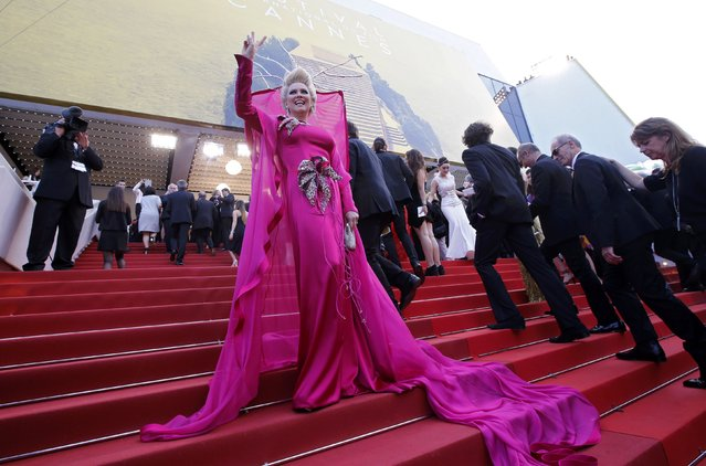 """TV personality Elena Lenina poses on the red carpet as she arrives for the screening of the film """"Money Monster"""" out of competition during the 69th Cannes Film Festival in Cannes, France, May 12, 2016. (Photo by Jean-Paul Pelissier/Reuters)"""