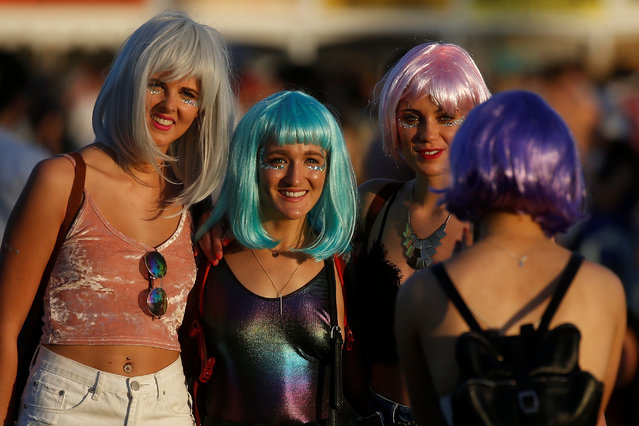 Women pose for a photo during the Coachella Valley Music and Arts Festival on April 16, 2017 in Indio, California. (Photo by Carlo Allegri/Reuters)