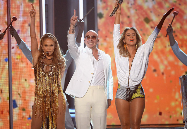 (L-R) Singer/actress Jennifer Lopez, recording artist Pitbull and singer Claudia Leitte perform onstage during the 2014 Billboard Music Awards at the MGM Grand Garden Arena on May 18, 2014 in Las Vegas, Nevada. (Photo by Ethan Miller/Getty Images)