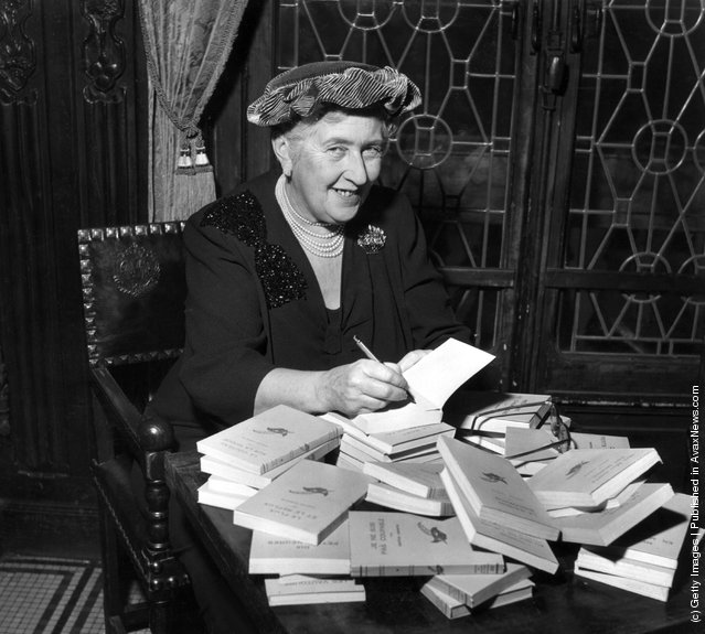 circa 1965:  British mystery author Agatha Christie (1890-1976) autographing French editions of her books