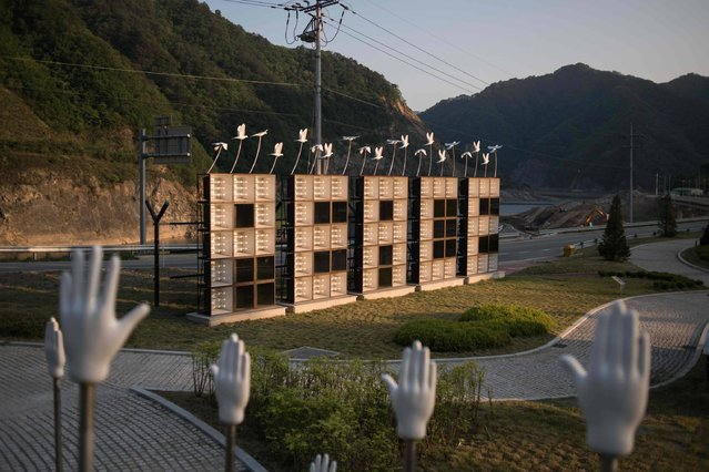 """A photo taken on May 21, 2017 shows an art installation featuring propaganda loudspeakers arranged to read: """"Peace"""", at the Peace dam, north of Hwacheon near the Demilitarized Zone (DMZ) separating North and South Korea. (Photo by Ed Jones/AFP Photo)"""